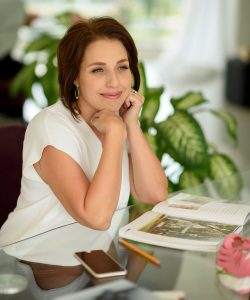 Kristin Crawford, Mexico Destination Wedding Planner and Designer sits at her desk in her Puerto Vallarta based office