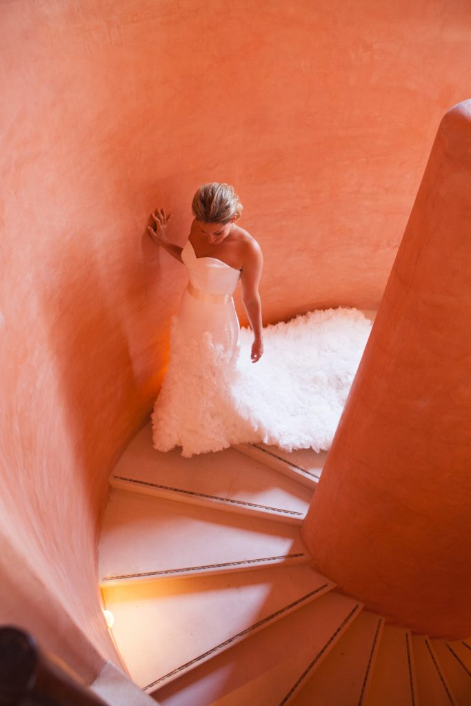 Dazzling brides descends stairs at Destination wedding in Mexico