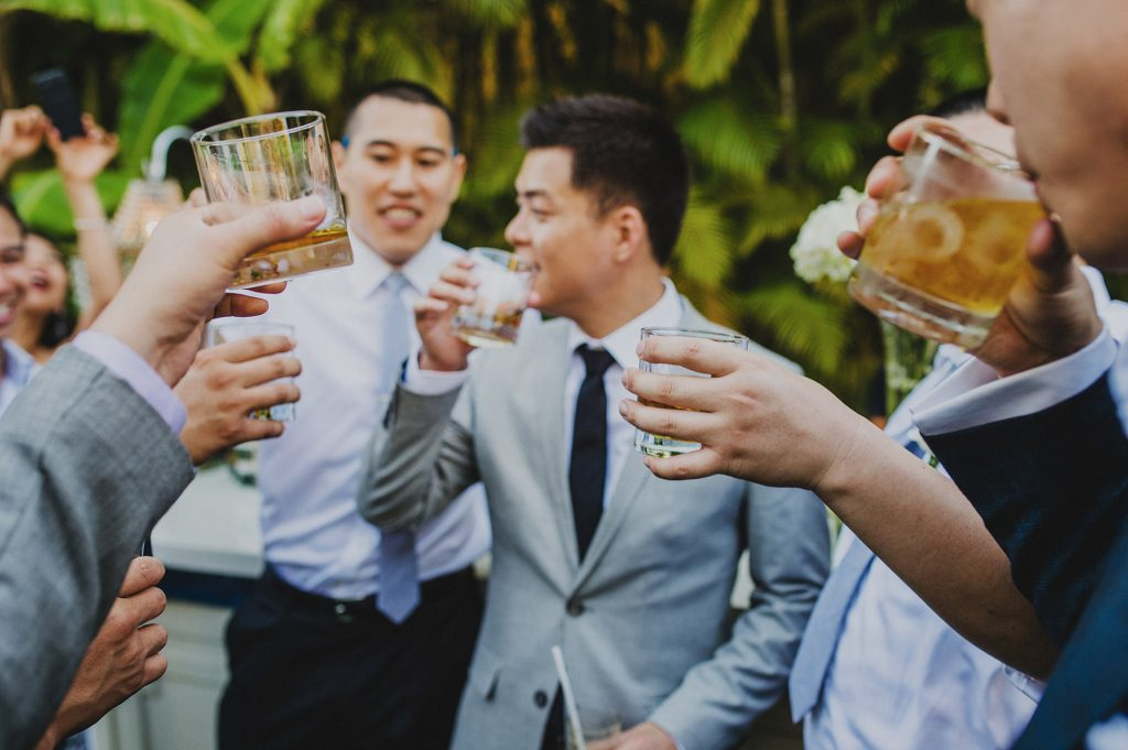 Groomsmen sipping bourbon during a destination wedding in mexico