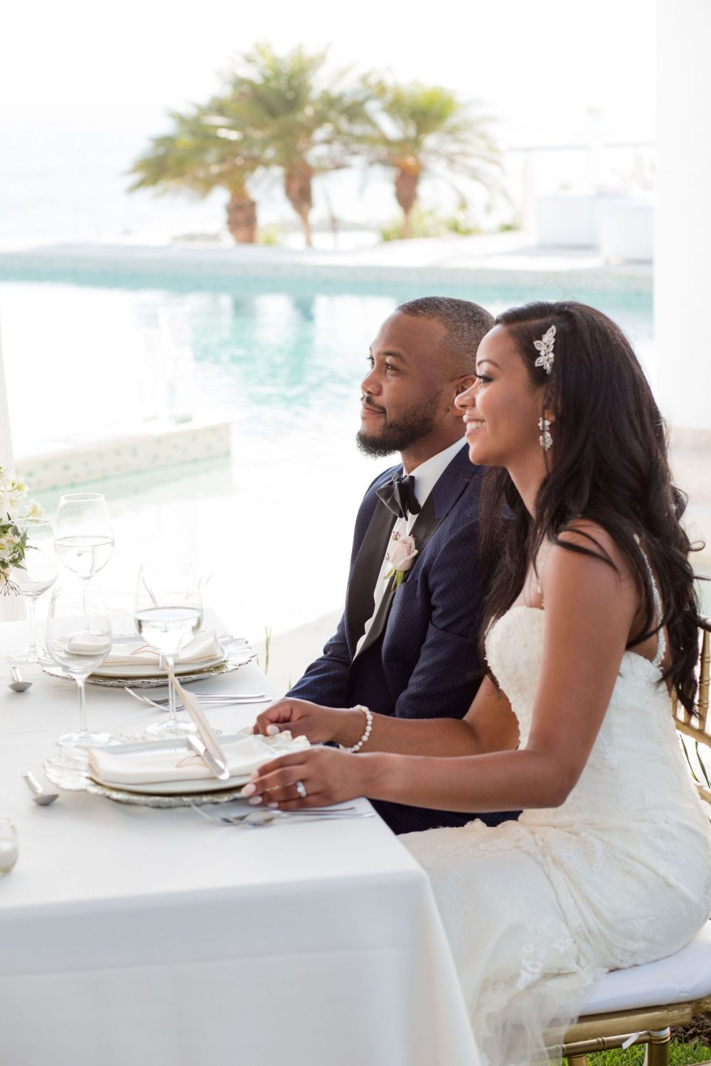the bride and groom listen to toasts during dinner at this Punta Mita Mexico destination wedding