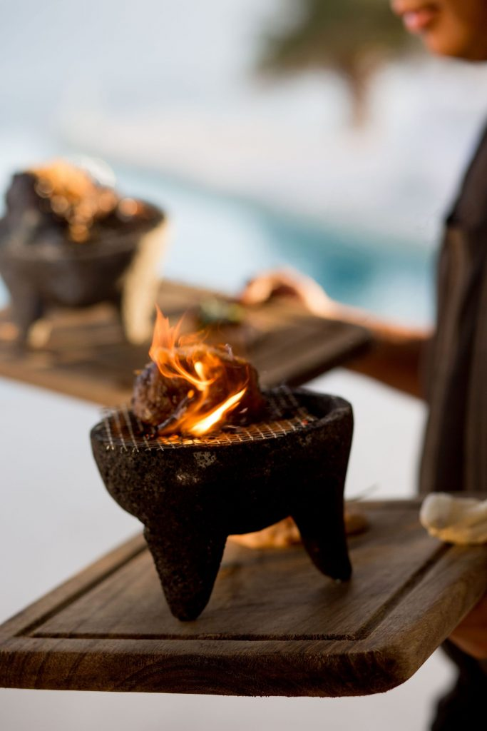 a delicious molcajete entree served by waiters at this Punta Mita Mexico destination wedding