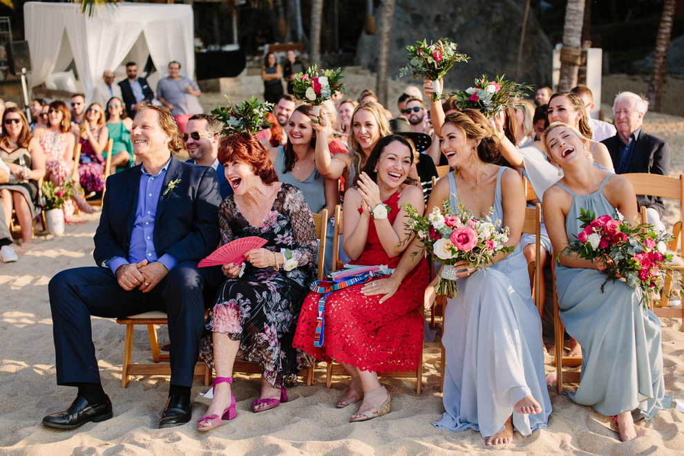 Guests laugh during the wedding ceremony at this Sayulita Mexico destination wedding