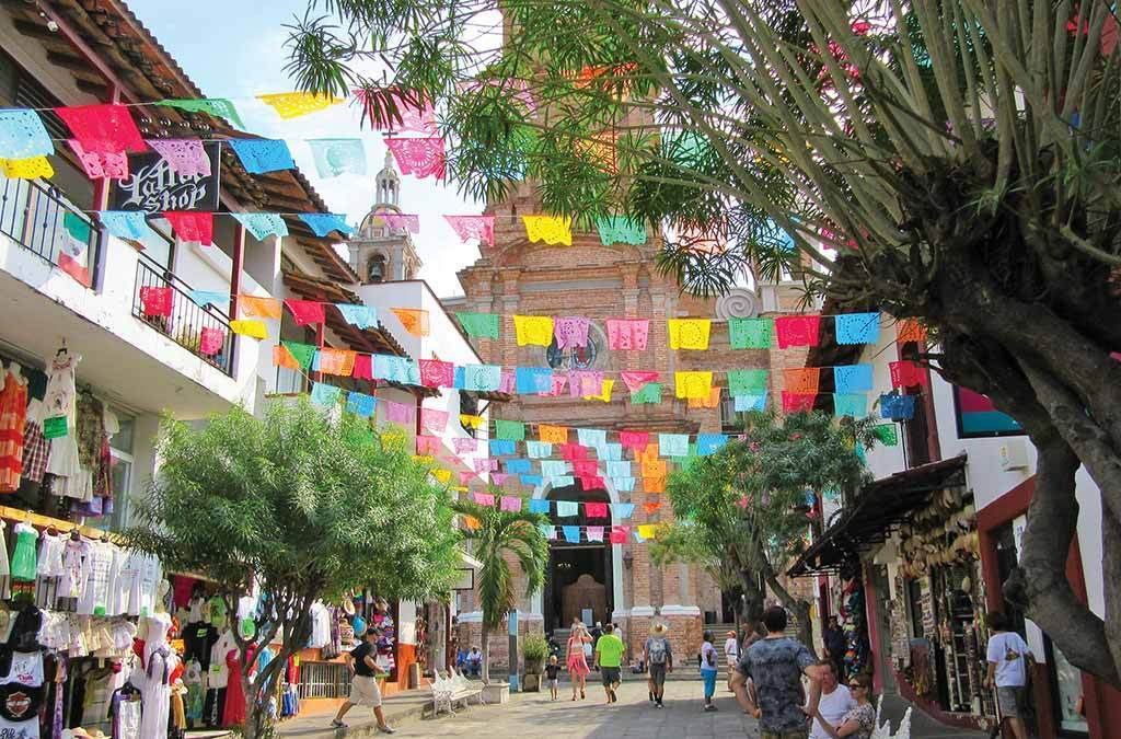 Puerto vallarta street with papel picado and the famous church