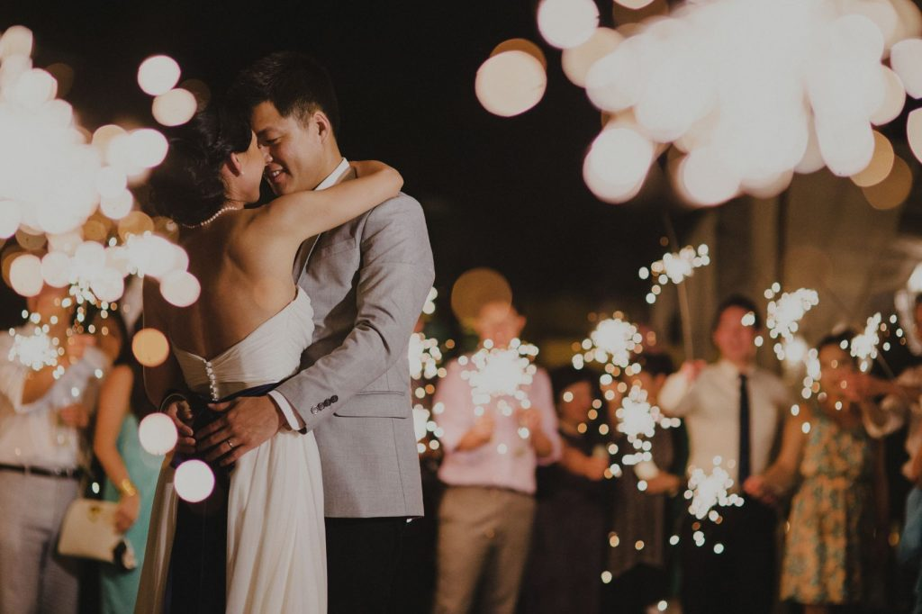 One of the most consistently magical moments at weddings is a sparkler dance like the bride and groom encircled by guests at this Punta Mita Mexico destination wedding