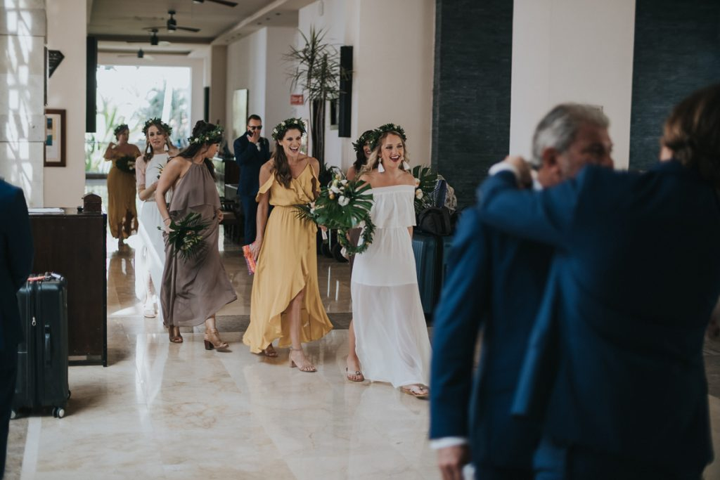 The bride and bridesmaids walk into the hotel lobby on their way to the Puerto Vallarta Mexico destination wedding ceremony