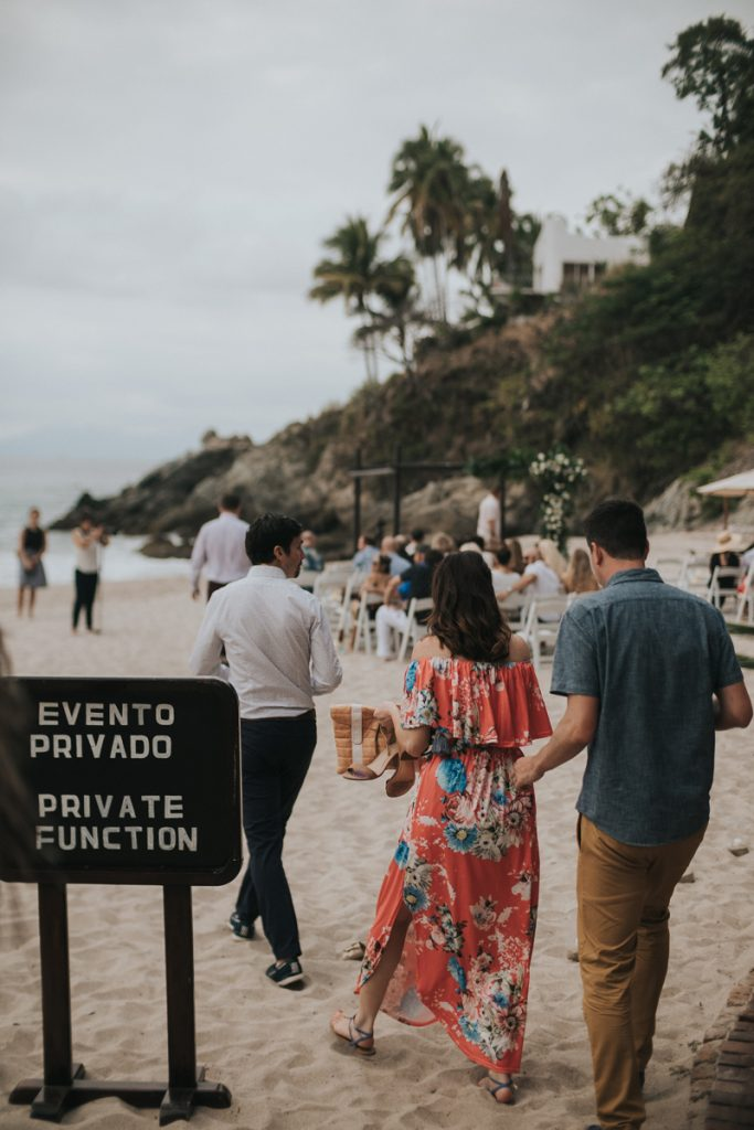 Guests attend a beach ceremony at a Puerto Vallarta Mexico destination wedding
