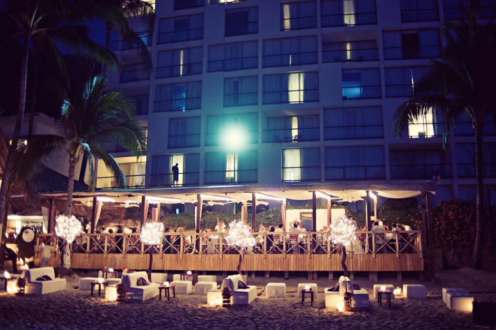 The beach lounge area set beneath the hotel tower at this Puerto Vallarta Mexico destination wedding