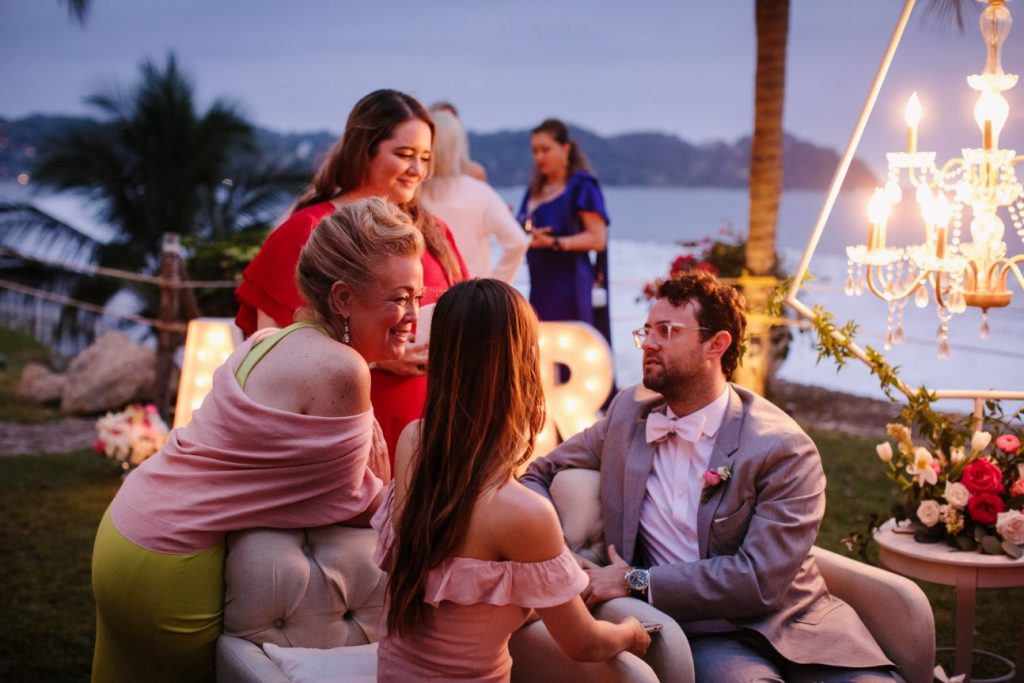 Guests mingle during cocktail hour at this destination wedding in Sayulita Mexico