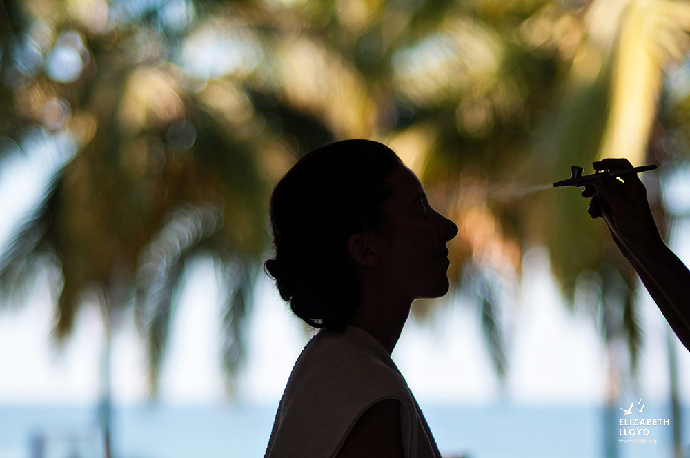 A bride gets her makeup done by a professional at her destination wedding in Puerto Vallarta, Mexico.