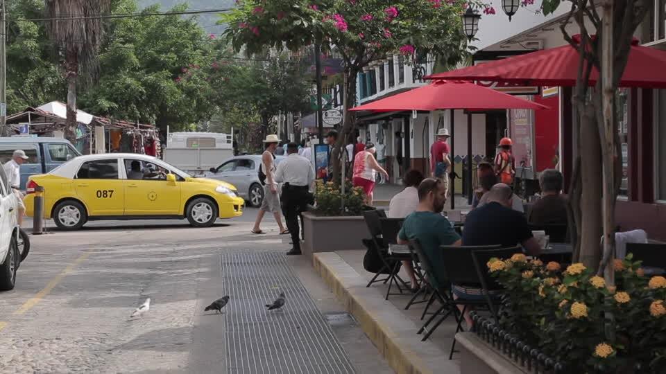 busy cobblestone street in puerto vallarta, mexico