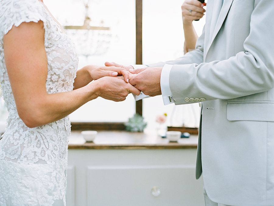 Bride and groom exchange rings during a destination wedding in Punta Mita Mexico.