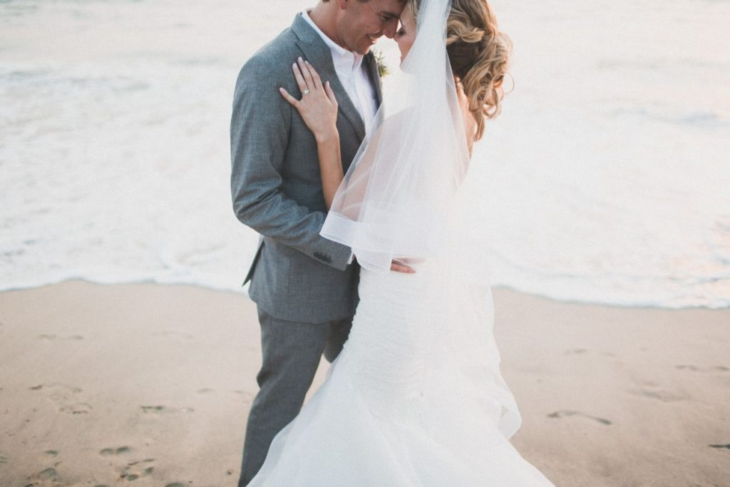 Bride and groom kiss on the beach after their destination wedding ceremony in Punta Mita Mexico